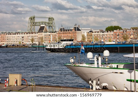 City of Rotterdam urban scenery, riverside housing, barges and ships on Nieuwe Maas river in South Holland, Netherlands. - stock photo
