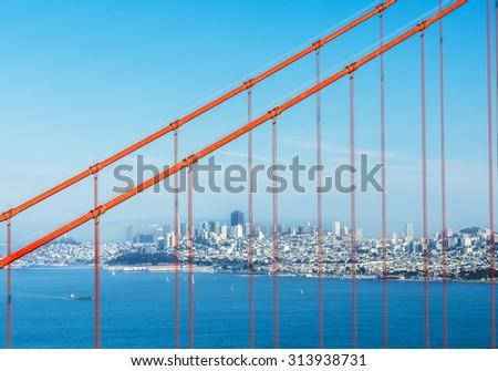 City of San Francisco seen through wires of the Golden Gate Bridge. California, USA - stock photo