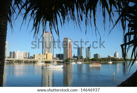 City of Southport on the Gold Coast Australia seen across the Nerang River just after sunrise. - stock photo