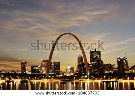 City of St. Louis downtown with Gateway Arch at twilight, Missouri, USA - stock photo