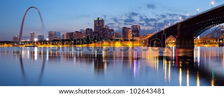 City of St. Louis skyline. Panoramic image of St. Louis downtown with Gateway Arch at twilight. - stock photo