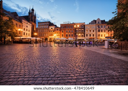 City of Torun in Poland, cobbled, medieval Old Town Market Square in the evening