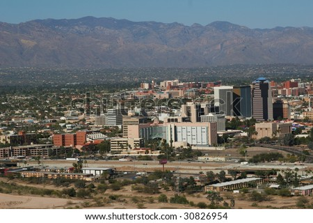 City of Tucson, seen with mountains in the background, as well as the University of Arizona - stock photo