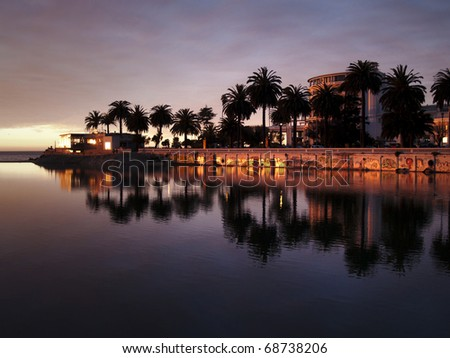 City of Vina del Mar (Chile) reflecting on the river Marga Marga at dusk - stock photo