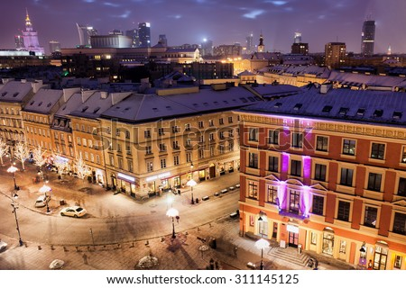 City of Warsaw in Poland by night, old apartment buildings and tenement houses on Krakowskie Przedmiescie street, downtown skyline.
