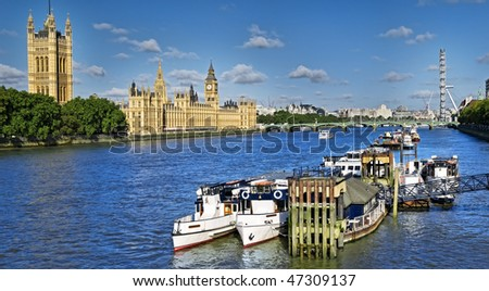 City of Westminster is one of the most visited place in UK.  This view includes: Big Ben, Houses of Parliament, and London Eye. - stock photo