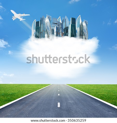 City on clouds in sky above highway road - stock photo