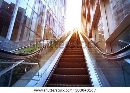 City outdoor escalator under the sun - stock photo