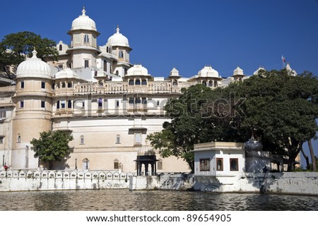 City palace from lake Pichola in Udaipur, India - stock photo