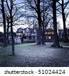 City park at dusk near residential houses - stock photo
