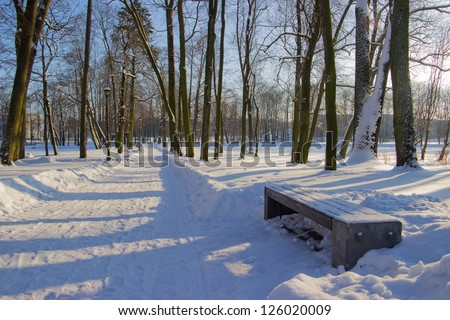 City park covered with snow - stock photo