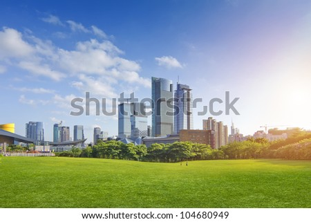 City park under blue sky with Downtown Skyline in the Background - stock photo