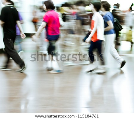 city people crowd in a station of the metro abstract background blur action