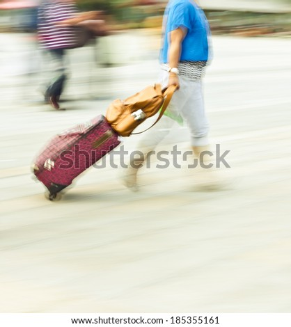 city people dragging luggage rush boarding, blurred color image