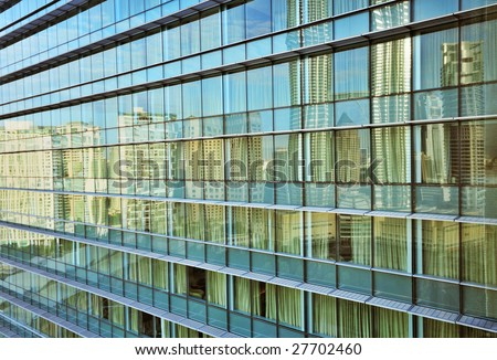 City Reflections in Modern Glass & Steel Building - stock photo