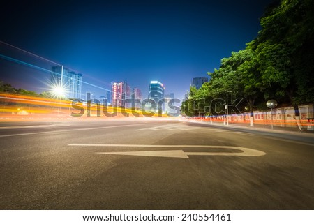 city road at night , light trails with traffic sign   - stock photo