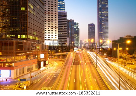 City road light trails of streetscape buildings backgrounds in HongKong - stock photo