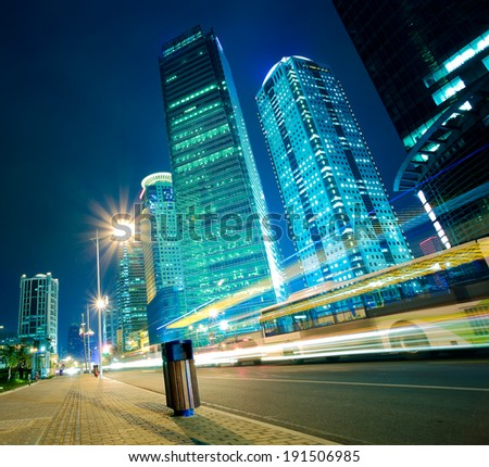 City road light trails of streetscape office buildings backgrounds in shanghai - stock photo