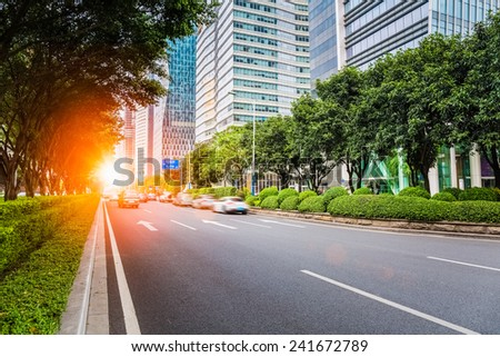 city road scene of guangzhou central business district in pearl river new town  - stock photo