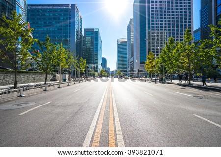 city road through modern buildings in beijing - stock photo