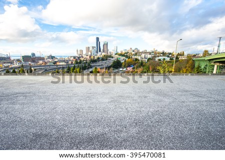 city road with cityscape and skyline of seattle - stock photo