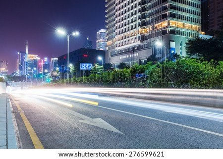 city road with modern buildings in guangzhou at night - stock photo
