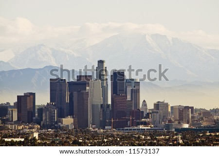 City-scape of downtown Los Angeles with mountains and clouds behind