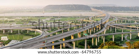 City scenery of transport buildings with highway and interchange, panoramic cityscape in day in Taiwan, Asia. - stock photo