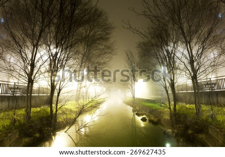 City scenery.Water channel and fog.City street at winter night - stock photo