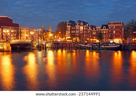 City scenic from Amsterdam in the Netherlands by night - stock photo