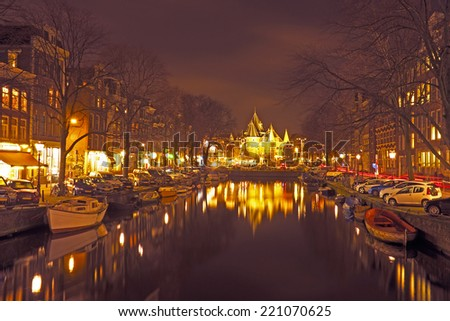 City scenic from Amsterdam with the Waag building in the Netherlands by night - stock photo