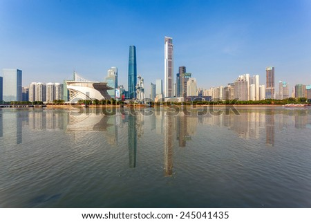 city skyline and reflection in guangzhou , beautiful pearl river new town at daytime ,China