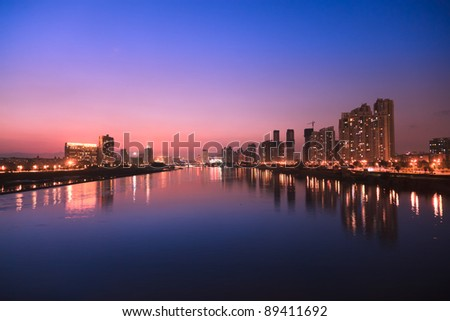City skyline at twilight.Cityscape  by the river of Minjiang,Fuzhou,China - stock photo