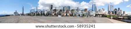 City skyline of buildings viewed from one of the piers in downtown Seattle