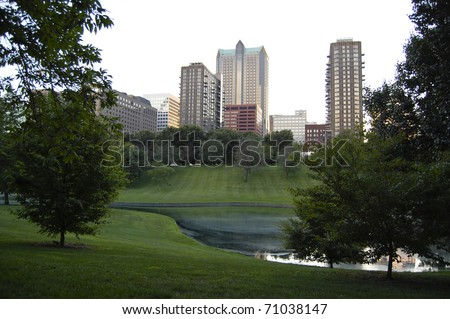 City skyline of St. Louis, Missouri as seen from Jefferson National Expansion Memorial park - stock photo