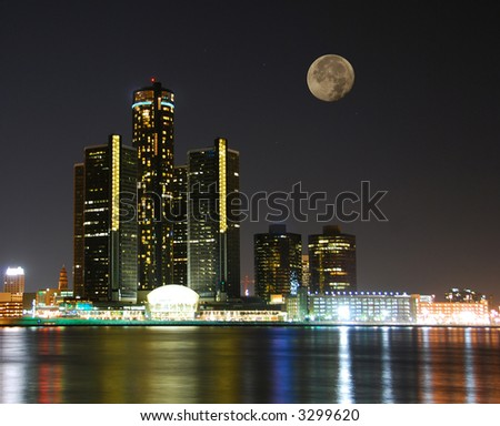 City skyline under moonlight - stock photo
