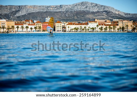 City Split coastline view from the sea with the windsurfer in Croatia - stock photo