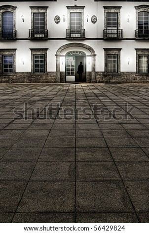 City street in night with silhouette of business man indoor. - stock photo