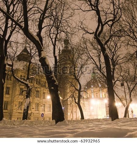 City street in winter night - stock photo