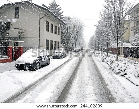 city street with white snow in the winter - stock photo