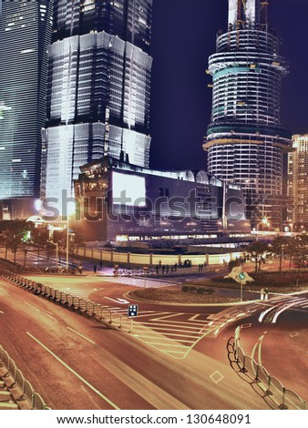 City streets and skyscrapers at night - stock photo