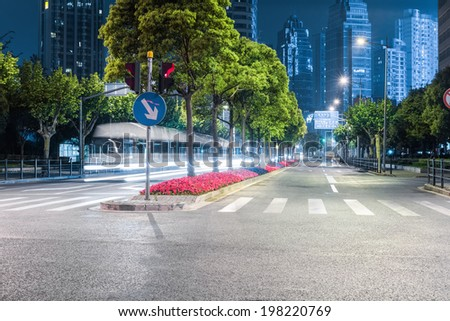city streets at night and modern building background in shanghai - stock photo