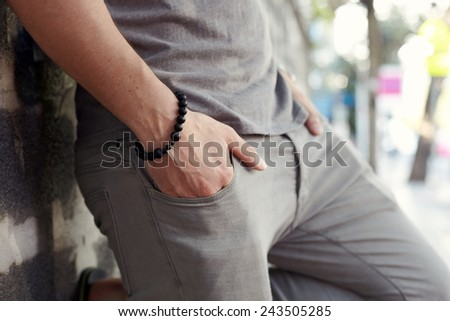 City styl portrait young man on the strreet - stock photo