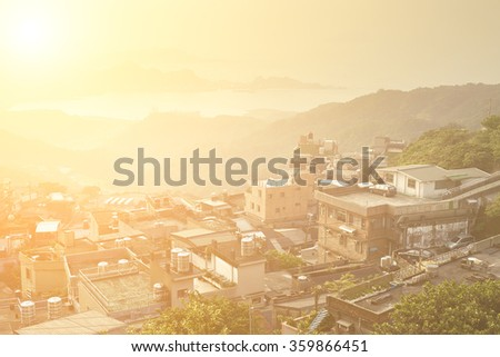 City sunset scenery with buildings on hill and harbor far away in Jiufen(Jioufen), Taiwan, Asia. - stock photo