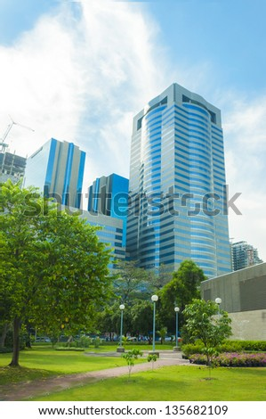 City tower in green park. - stock photo