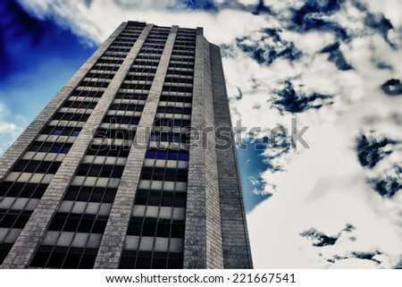 city tower urban sky with clouds - stock photo