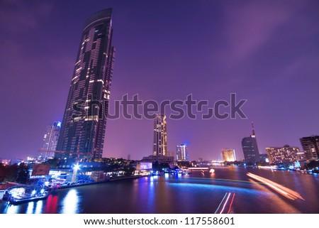 City town at night, Taksin Bridge, Thailand - stock photo