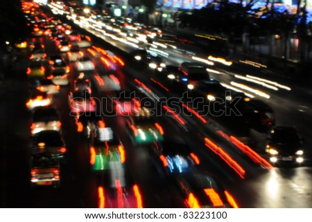 City Traffic at Night - Soft Focus with Motion Blur - stock photo
