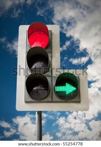 City traffic light on blue sky background. - stock photo