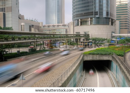 City traffic with cars motion blurred on the road. - stock photo